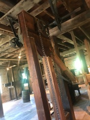 Grain Elevators: Mills were usually tall structures to utilize the gravity flow of grain from one processtothe next. When grain was moved to a higher level in the mill, grain elevators were used. There are small buckets attached to a continuous loop of belting traveling between two pulleys.